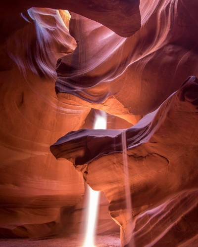 Antelope canyon lit by sunbeams